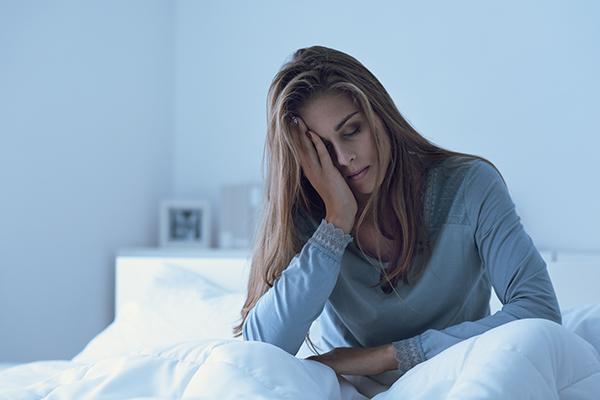 groggy woman waking up | fitness goals