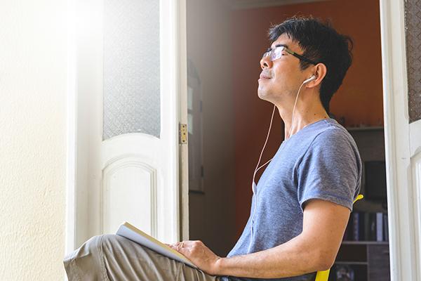 man meditating and journaling | daily meditation tips