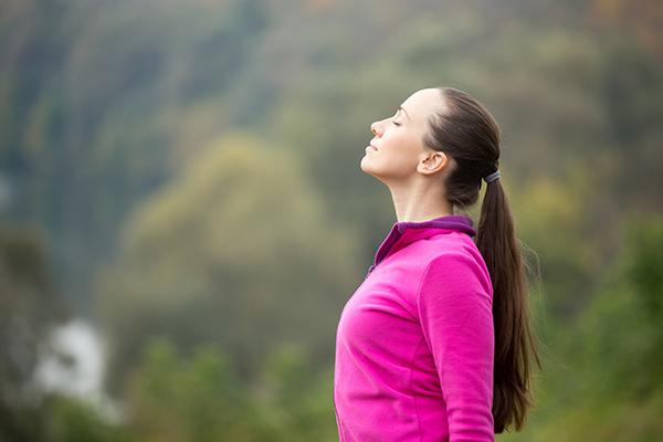 woman meditating during walk | daily meditation tips