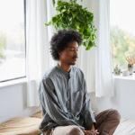 man meditating before starting day | daily meditation tips