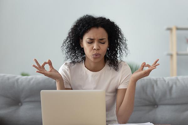 woman struggling to focus during meditation | morning meditation
