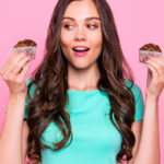 woman holding up two muffins | sugar free 3 approved desserts