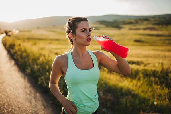 woman drinking supplement drink   how long does pre workout last