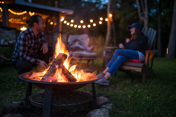 couple around bonfire | alternatives to trick or treating