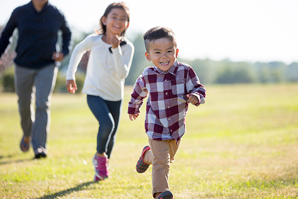 family playing tag at a park   homeschool PE ideas