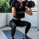 kelsey doing dumbbell squats | full body workout routine