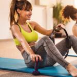 woman using pilates ring | pilates ring