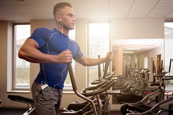 man running on elliptical | elliptical vs treadmill