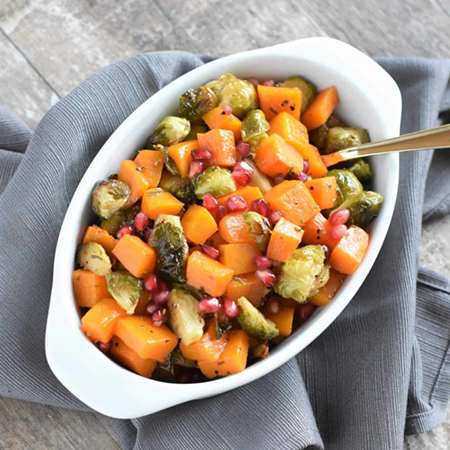 roasted butternut squash and brussels sprouts with pomegranate | vegan thanksgiving sides