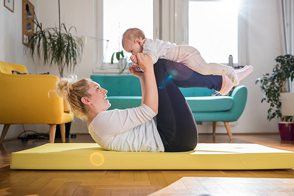 mother exercising with infant | exercise and pregnancy