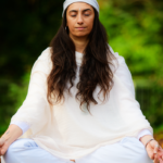 woman in white clothes and head covering | kundalini
