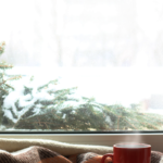 cozy house during snowy weather | holiday stress pandemic