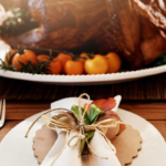 plate in front of thanksgiving turkey | thanksgiving buffet