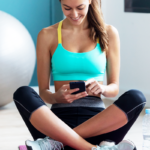 athlete on yoga mat looking at phone | how many classes per week