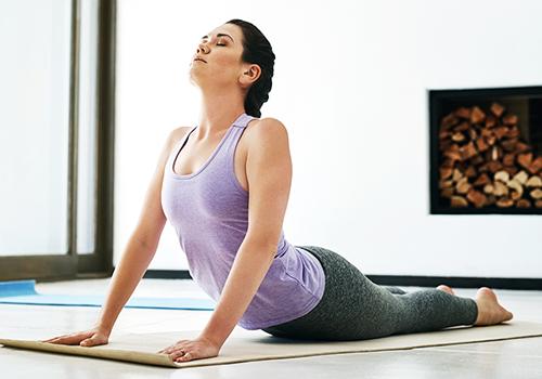 woman doing yoga | thanksgiving guide