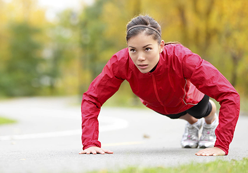woman exercising outside | thanksgiving guide