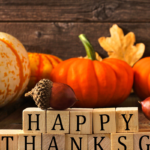 happy thanksgiving sign in front of pumpkins | thanksgiving guide