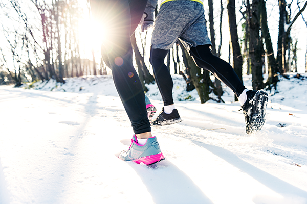 shot of a couple's legs running | how to stay fit in winter