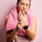 athlete holding her wrist   sore wrists