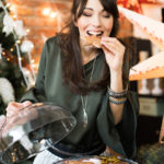 woman enjoying christmas cookie | eat the cookie