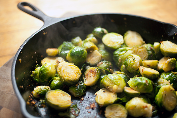 brussels sprouts cooking on a pan | how to cook brussels sprouts