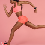 athlete running with pink background | pose running
