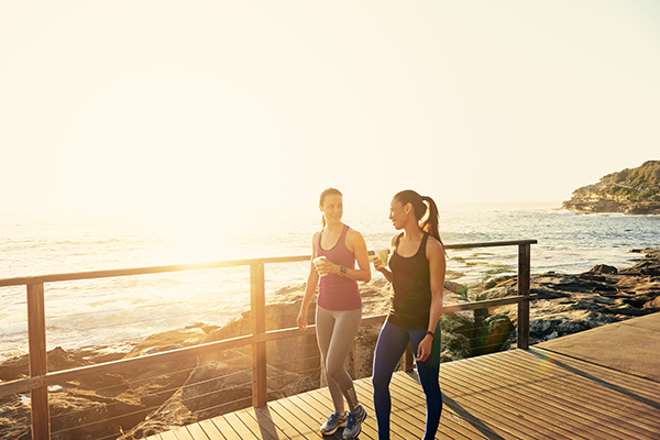 2 women walking on coast | walking vs running