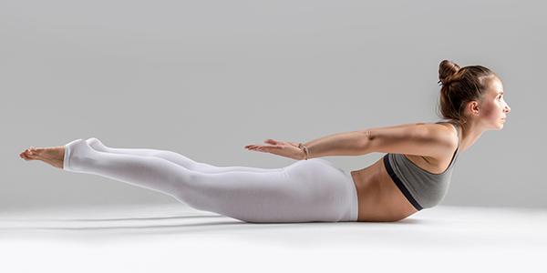 woman doing locust pose | yoga core workout
