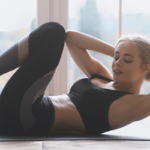 woman doing crunches | yoga core workout