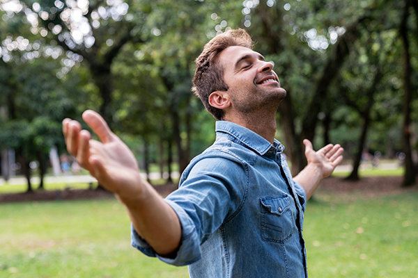 happy man celebrating outdoors | meditation challenge