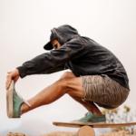 man doing pistol squat on balance board | proprioception exercises