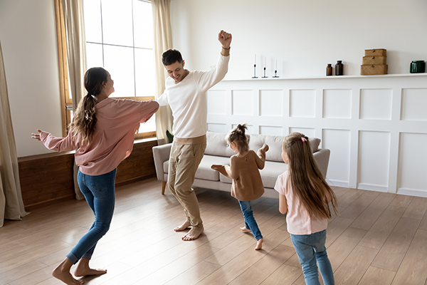 family dancing at home | benefits of stretching
