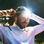 man putting on head lamp before run | night running gear