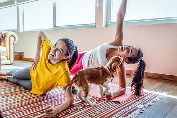 women doing yoga with dog | body neutrality