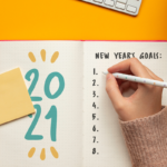 woman writing resolutions for 2021 | new years resolutions