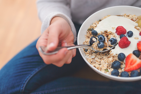 bowl of yogurt with fruit and oats | gut health