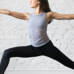 woman doing warrior 2 | yoga for self esteem