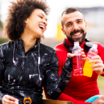 man and woman drinking sports drink | workout supplements