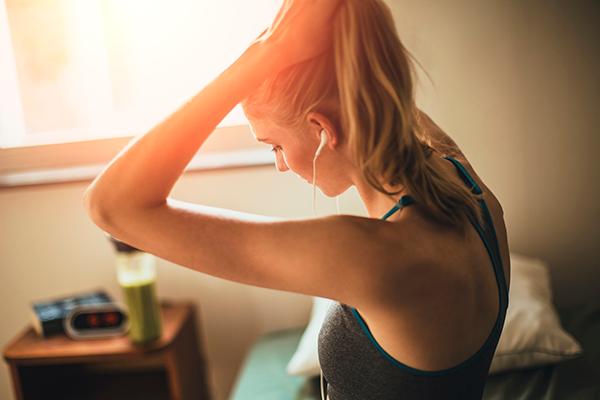 woman getting ready for run | intrinsic motivation