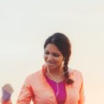 woman celebrating after run | intrinsic motivation