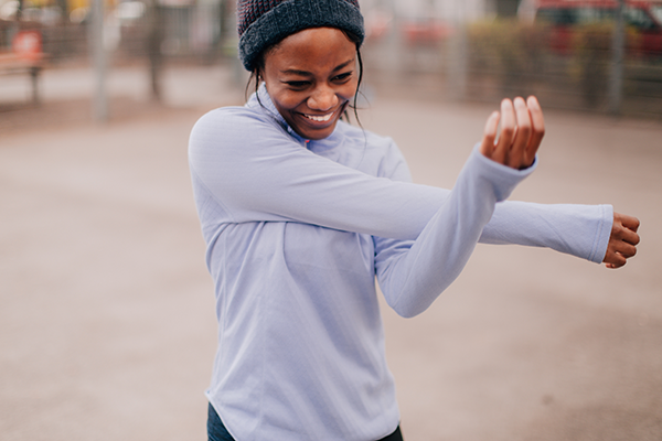 woman stretching for run | intrinsic motivation