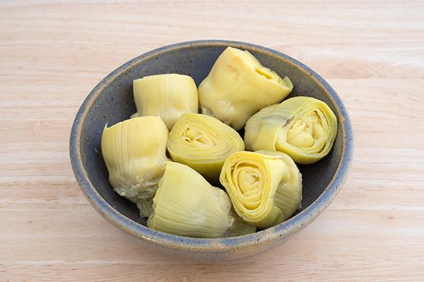 artichoke hearts in a bowl | how to cook artichokes