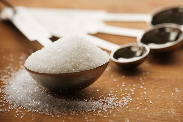 sugar in measuring spoon | is dried fruit healthy