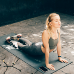 woman stretching outside on yoga mat   stretching routine