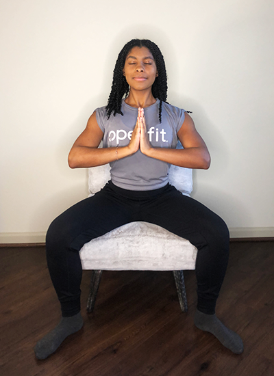trainer morgan demonstrating goddess pose | chair yoga