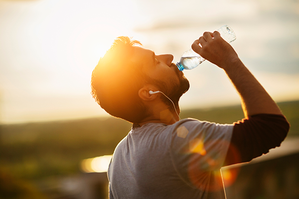 man drinking water during run | what to eat after a workout