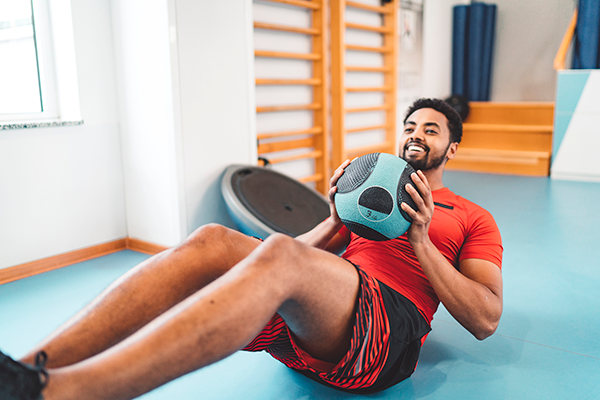 man working out with medicine ball | sugar and sleep