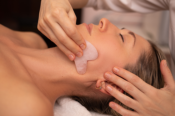 woman receiving gua sha massage | gua sha