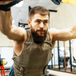 man using trx trainer with weighted vest | weighted vests