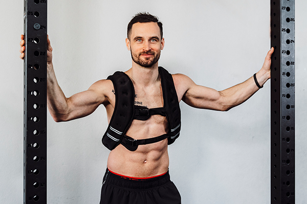 man with weighted vest posing | weighted vests